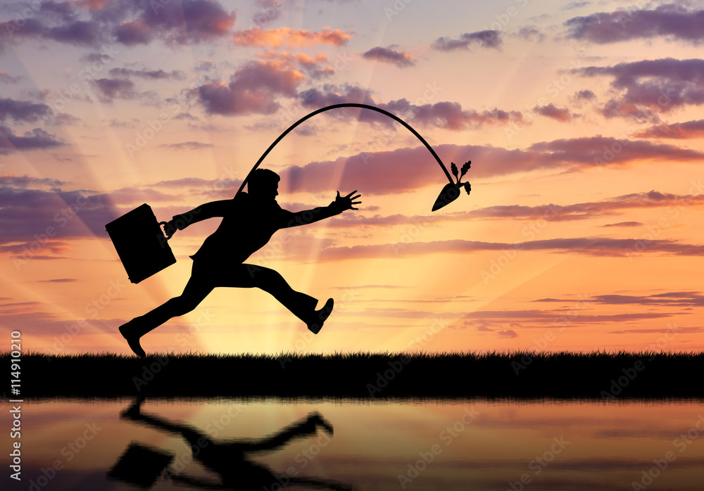 Fototapety, obrazy: Silhouette of businessman running for the carrot and reflection in water.