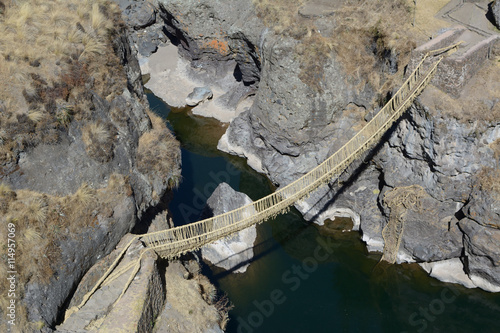 Fotografie, Obraz  Ancient rustic bulrush sedge suspension bridge