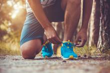 Runner Tying Shoelaces On Sneakers.