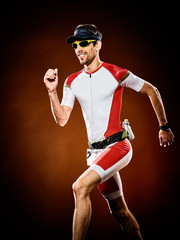 Fototapeta Sport man runner running triathlon ironman isolated