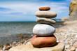 stone pyramid of pebble on sea