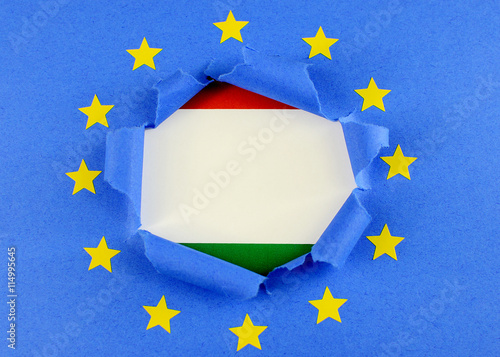 The Red White And Green Flag Of Hungary Is Behind The Torn Open