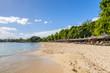 Mauritius beach umbrellas, thatch. Tropical Mauritius island water & beach resort, Turtle Bay - Balaclava