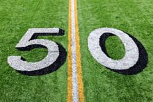 50 Yard Line On A Green Footba...