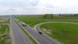 Aerial view of a truck and other traffic driving along a country road. 1080p.