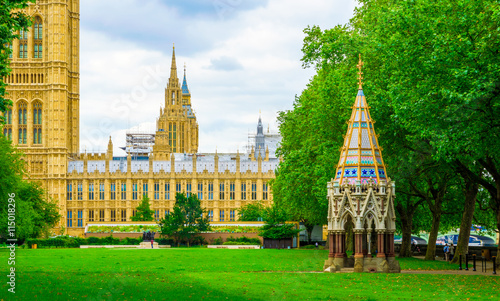 Canvas Print Palace of Westminster and Buxton Memorial Fountain in Victoria Tower Gardens in
