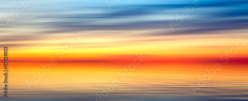 Foto op Aluminium Oranje Nice bright red yellow blue abstract blur texture background panorama landscape with sunset on lake
