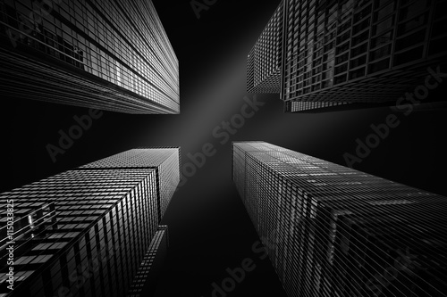 Architectural fine-art black and white photograph with four New York skyscrapers converging towards the sky