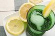 Carbonated Water with Lemon in Green Glass