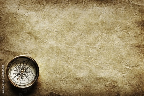 Fotografia, Obraz Close up view of the Compass on the old paper background