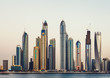 View of Dubai Marina skyline at sunset. Scenic travel background.
