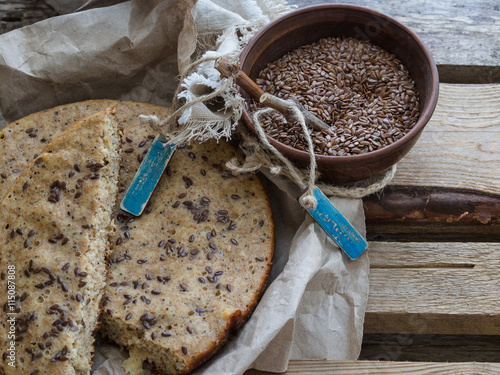 fototapeta na drzwi i meble grain bread with flax on wooden boards