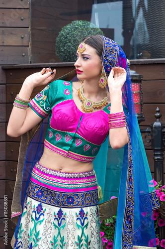 fototapeta na lodówkę Beautiful young indian woman in traditional clothing
