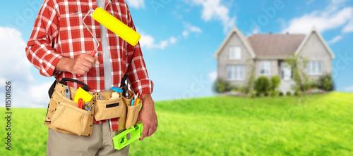Foto auf Gartenposter Gelb Builder handyman with paint roller.