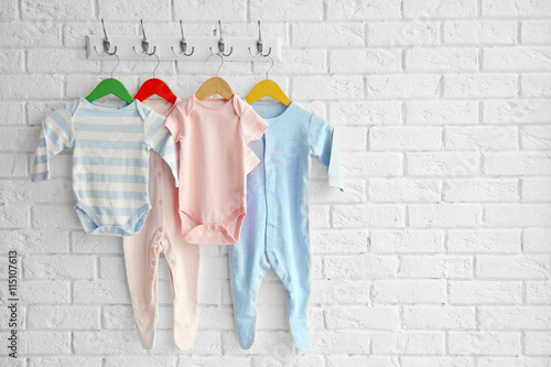 bdb6334a25a0 Colorful set of baby romper on brick wall - Buy this stock photo and ...