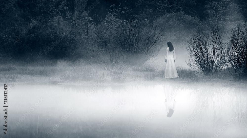 Fototapeta Lady at the lake, vintage filter - horror scene