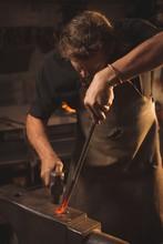 Blacksmith Working On Hot Meta...