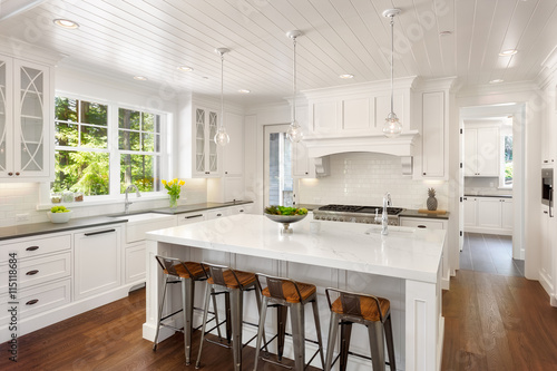 Beautiful White Kitchen In New Luxury Home With Lights On