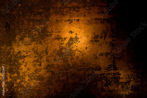Fototapeta old scary rusty rough golden and copper metal surface texture/background for Halloween or haunted house games background/texture of wall obraz