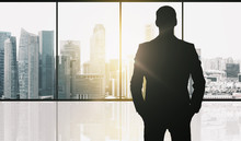 Silhouette Of Business Man Ove...
