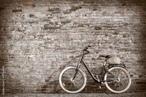 Aluminium Prints Bicycle Black retro vintage bicycle with old brick wall.