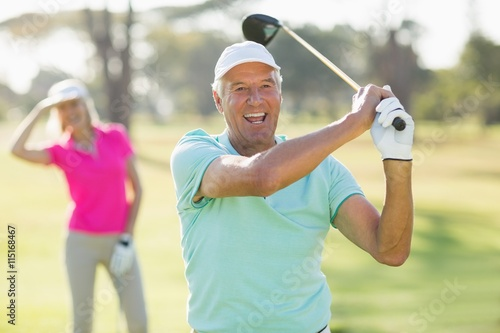 Tuinposter Golf Portrait of cheerful mature golfer holding golf club