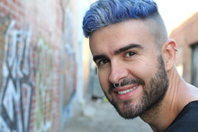 Portrait Of Young Beautiful Bluehead Stylish Boy With Fancy Look Smiling