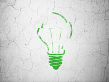 Finance Concept: Light Bulb On Wall Background