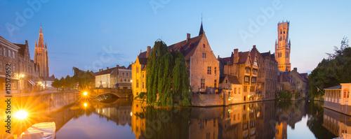 Wall Murals Bridges Panorama of Bruges, Belgium. Image with Rozenhoedkaai in Brugge, Dijver river canal and Belfort, Belfry, tower in twilight.