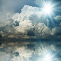 Fototapeta Niebo Sunbeam in the Dark Blue Clouds