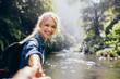 Leinwanddruck Bild - Female hiker holding hand of his boyfriend