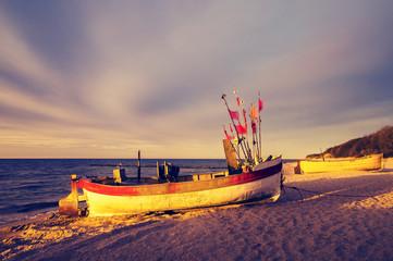 Fototapeta Morze Vintage retro stylized photo of fishing boats on the sea beach