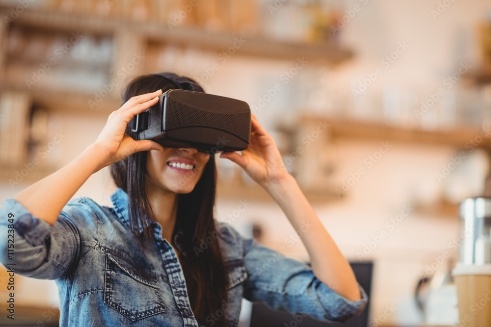 Fototapeta Young woman using the virtual reality headset