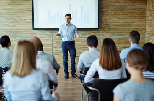 Businessman at conference Wallpaper Mural