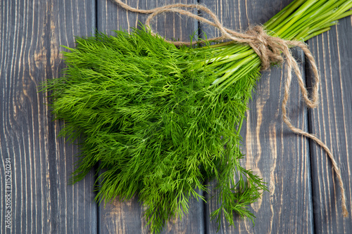 Bunch of fresh organic dill on the rustic wooden table Fototapet