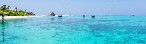 Photo Stands Turquoise Panorama of tropical lagoon on the island in Indian Ocean. Maldives.