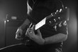 Close Up Of Man Playing Electric Guitar Shot In Monochrome