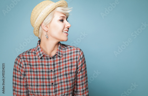 Carta da parati  Young fashion smiling girl hipster with short blond hair in hat and shirt