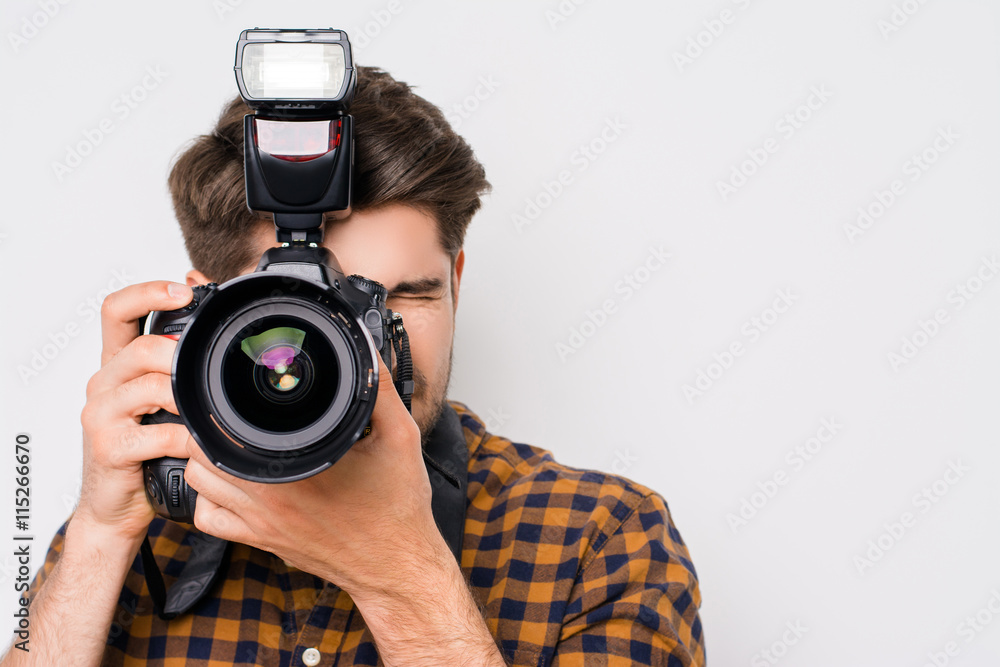 Fototapety, obrazy: Young man focusing with digital camera  isolated on white backgr