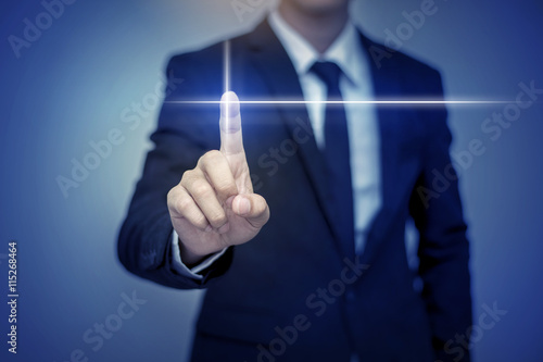 Fotografija  Close up of businessman touching digital screen with finger