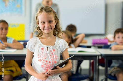 Aluminium Prints Amusement Park Cute girl holding digital tablet
