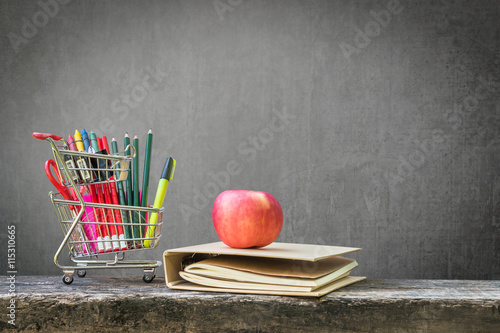 Back To School Shopping Cart Stationery Supplies Notebook Red Apple On Dark