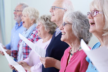Group Of Seniors Singing In Ch...