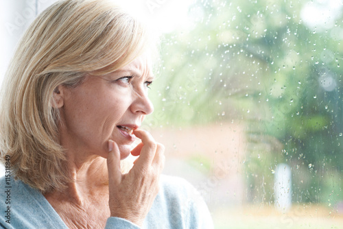Sad Mature Woman Suffering From Agoraphobia Looking Out Of Windo Canvas Print
