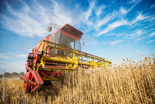 Close up of a harvester cropping the field. Canvas Print