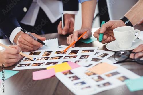 Obraz Cropped image of photo editors with documents - fototapety do salonu