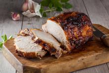 Roasted Pork On A Rustic Cutting Board