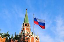 Flag Of Russia Against Troitskaya Tower Of The Moscow Kremlin