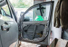 The Car In The Garage. Right Door With No Skin. Repair Of The Car..