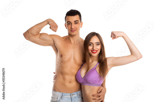 Fototapety, obrazy: Boyfriend and girlfriend showing muscles